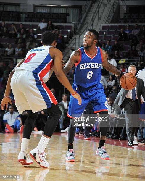 Tony Wroten of the Philadelphia 76ers looks to pass the ball against Spencer Dinwiddie of the Detroit Pistons during the game on October 23 2014 at...