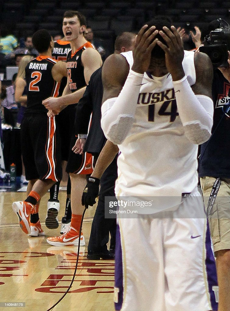 Tony Wroten #14 of the Washington Huskies covers his face as Angus Brandt #12 of the Oregon State Beavers celebrates after the Huskies lose to the Beavers 86-84 during the quarterfinals of the 2012 Pacific Life Pac-12 basketball tournament at Staples Center on March 8, 2012 in Los Angeles, California.