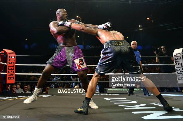 Tony Yoka of France and Jonathan Rice of The United States of America in action during an international heavyweight boxing match at Zenith on October...
