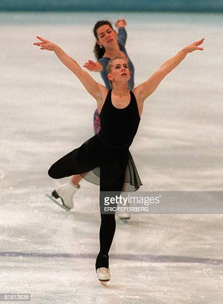 Tonya Harding of the United States and compatriot Nancy Kerrigan skate during a practice session 22 February 1994 in Hamar near Lillehammer at the...