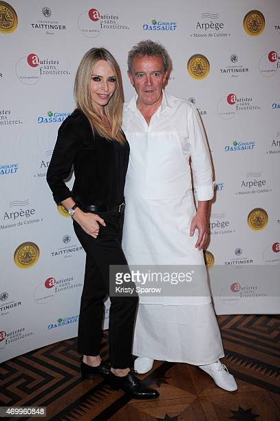 Tonya Kinzinger and Alain Passard attend the 'Autistes Sans Frontiere' Charity Gala at Artcurial Dassault on April 16 2015 in Paris France