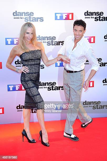 Tonya Kinzinger and Maxime Dereymez attend the 'Danse Avec Les Stars 2014' Photocall at TF1 on September 10 2014 in Paris France