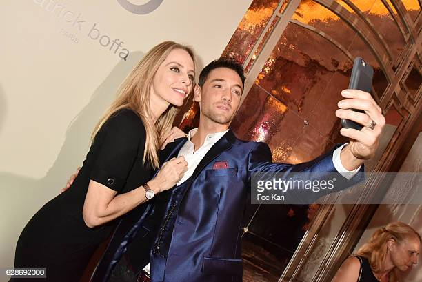 Tonya Kinzinger and Maxime Dereymez pose for a selfie during Patrick Boffa 2017 Collection Fashion Show at Plaza Athenee on December 8 2016 in Paris...