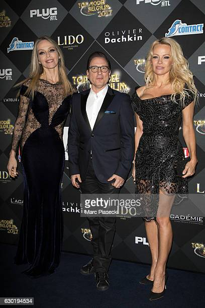 Tonya Kinzinger JeanMarc Genereux and Pamela Anderson attend 'Top Model Belgium 2017' at 'Le Lido' theater on December 18 2016 in Paris France