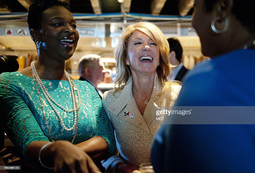 Tonya Veasey, left, wife of newly elected Congressman Marc Veasey, and state Sen. Wendy Davis, center, share a laugh with another guest at the Lone Star Project Inauguration Celebration, held Sunday, January 20, 2013 at Hill Country Barbecue in Washington, D.C.