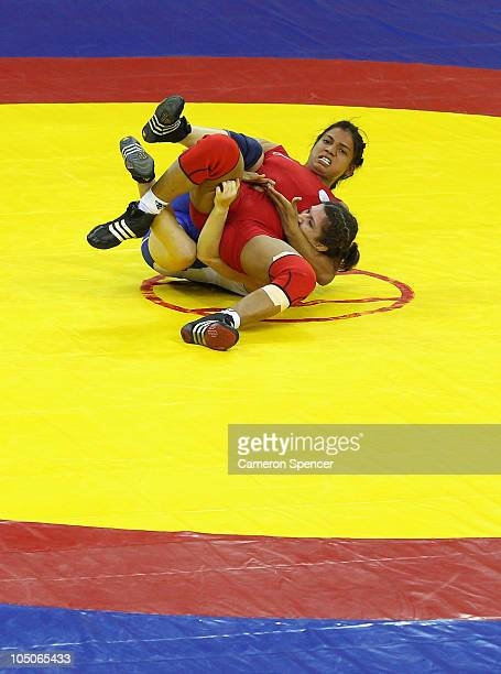 Tonya Verbeek of Canada competes against Alka Tomar of India during the women's 59kg gold medal wrestling at IG Sports Complex during day five of the...