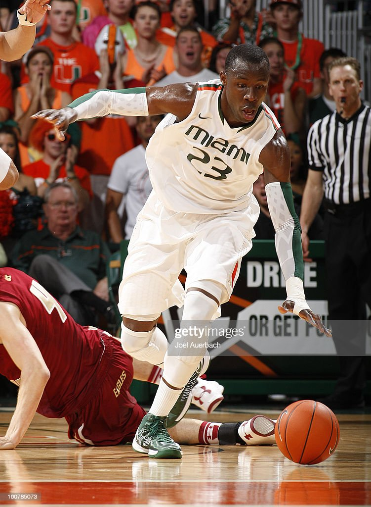 Tonye Jekiri #23 of the Miami Hurricanes goes after a loose ball against the Boston College Eagles on February 5, 2013 at the BankUnited Center in Coral Gables, Florida. The Hurricanes defeated the Eagles 72-50.