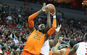Tonye Jekiri of the Miami Hurricanes grabs a rebound during the game against the Louisville Cardinals at KFC YUM Center on February 21 2015 in...