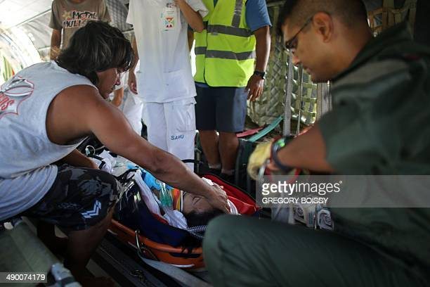 Tonyno father of a teenage victim of a motorcycle accident caresses his daughter's face beside members of the emergency medical service Samu and a...