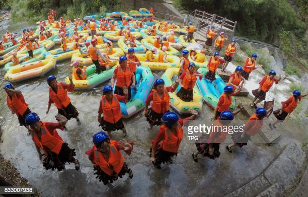 Too many rafts block up the riverway tourists dance square dancing to kill time at Yuxi Grand Canyon on 16th August 2017 in Lushi Henan China