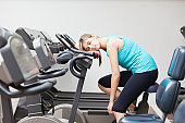 Young woman resting on the exercise machine.