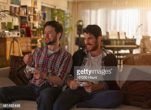 Too young men playing video games