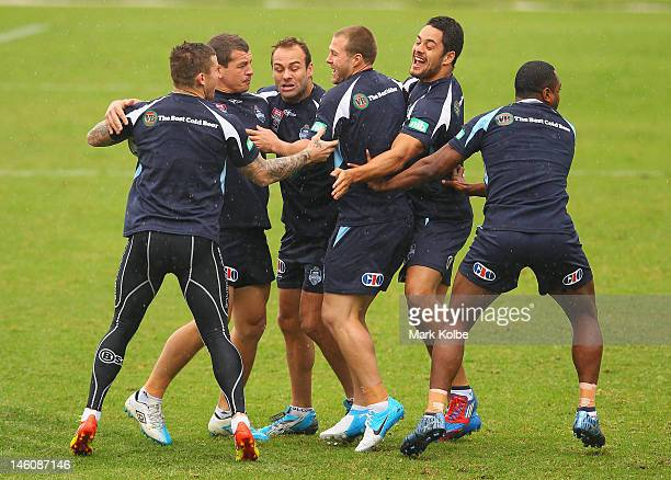 Tood Carney Greg Bird Brett Stewart Trent Merrin Jarryd Hayne and Akuila Uate take part in a warmup game during a New South Wales Origin training...