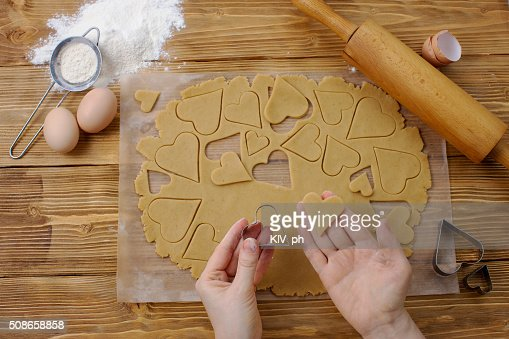 Tools and process of making heart cookies : Stock Photo