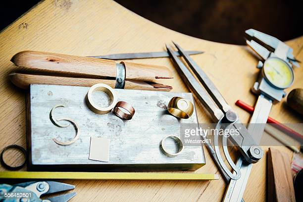 Tools and rings in workshop of a goldsmith