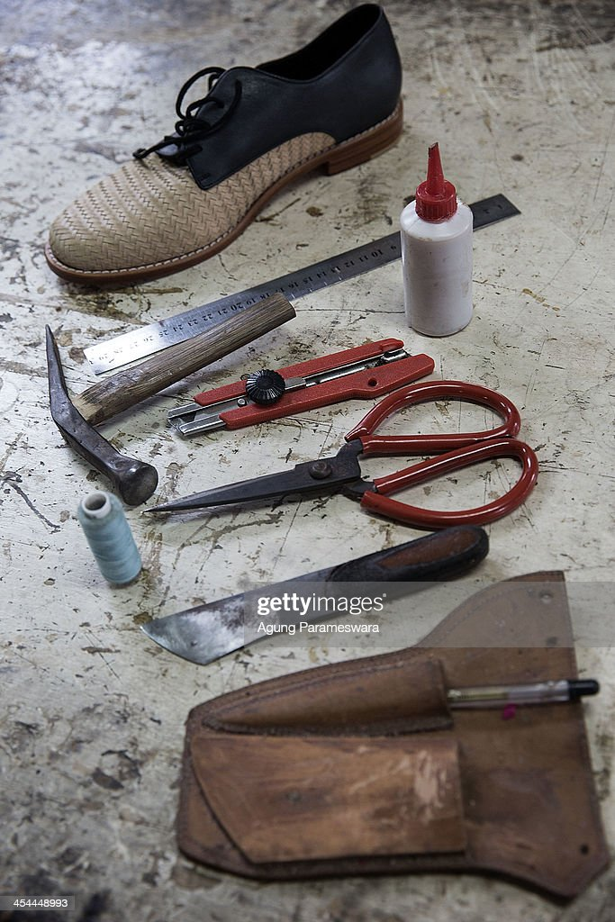 Tools are seen on a table that are used to make a shoes at Niluh Djelantik atelier on November 12, 2013 in Canggu Village, Bali, Indonesia. Niluh Djelantik (formerly called Nilou), the hand made high end leather shoe, is produced by Balinese shoe lover and designer Ni Luh Ayu Pertami with 40 shoes designers and workers in a small atelier at Canggu Village. This brand signature by a unique engraving and designed to be comfortable high heels or wedges with elegan touch. Celebrities like Cate Blanchett, Uma Thurman,Julia Roberts ,Paris Hilton, Cameron Diaz and American top model Gisele Bundchen have been known to purchase Niluh Djelantik beautiful shoes and sandals.
