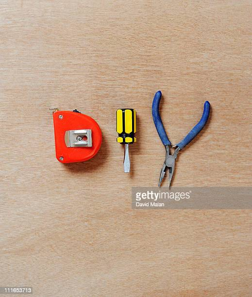 tools arranged to spell 'DIY'