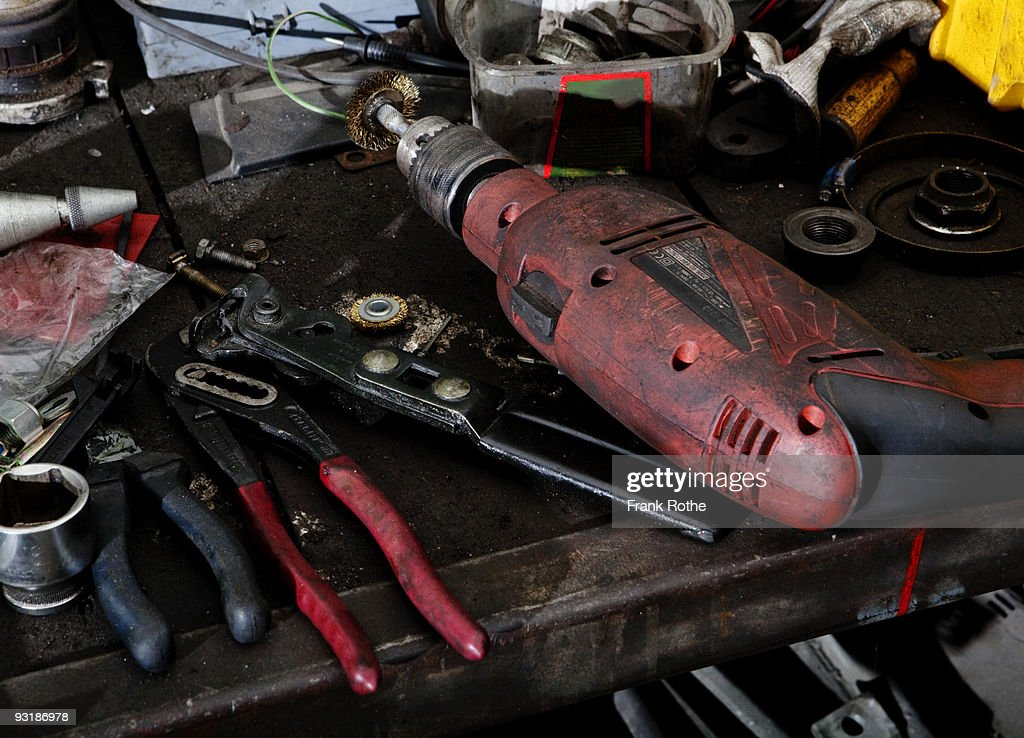 tools at a table in a garage : Stock Photo