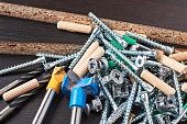 Tools for furniture assembly on wooden background closeup
