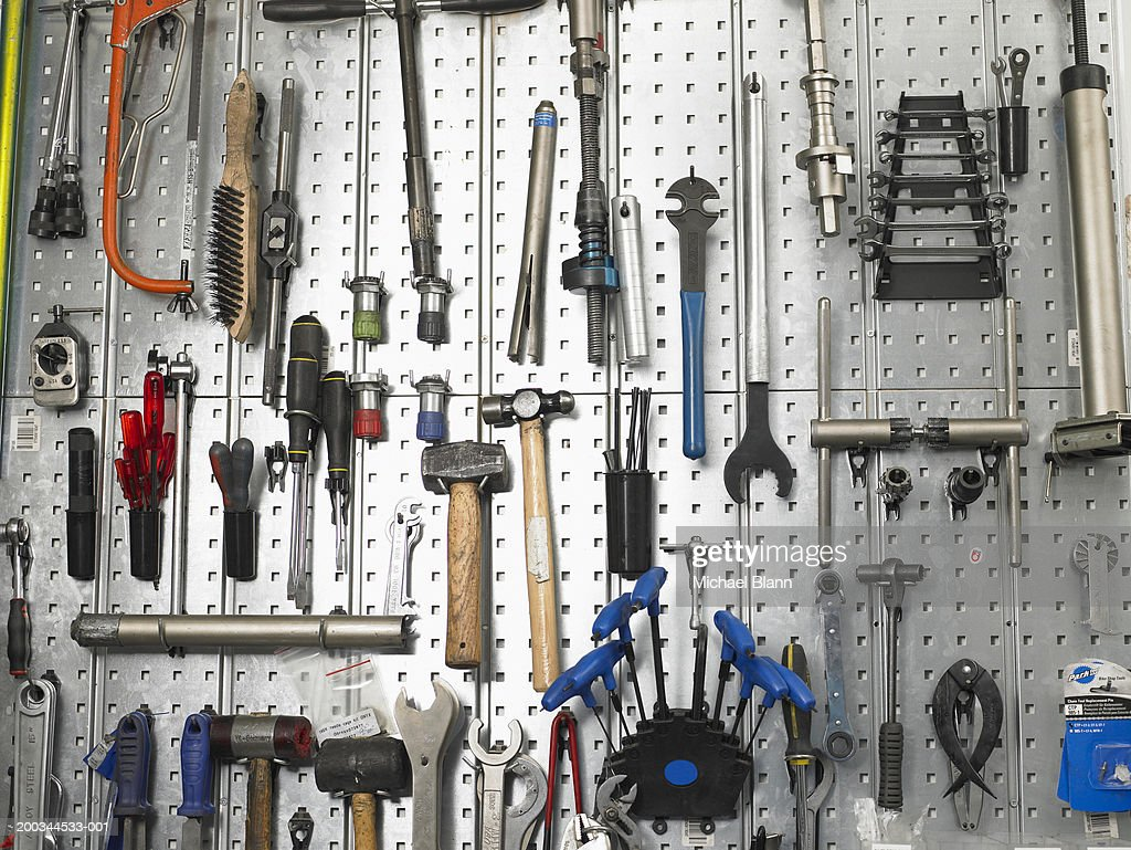 Tools hanging from wall : Stock Photo