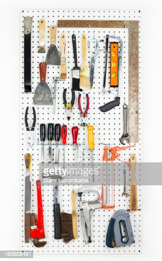 tools hanging on an organized pegboard stock photo getty images. Black Bedroom Furniture Sets. Home Design Ideas