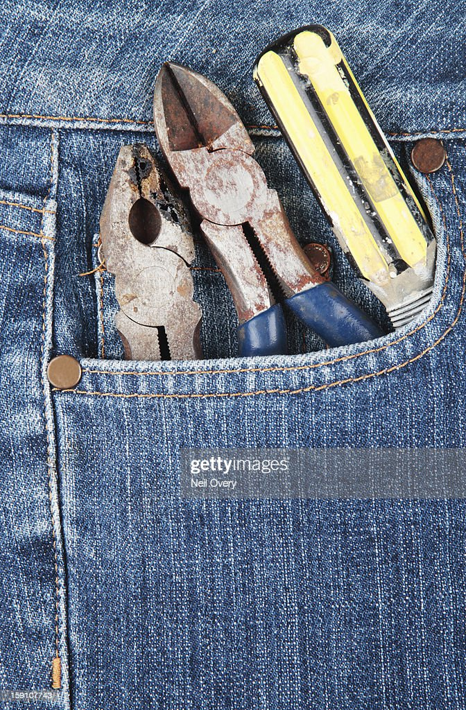 Tools in a denim jeans pocket : Stock Photo