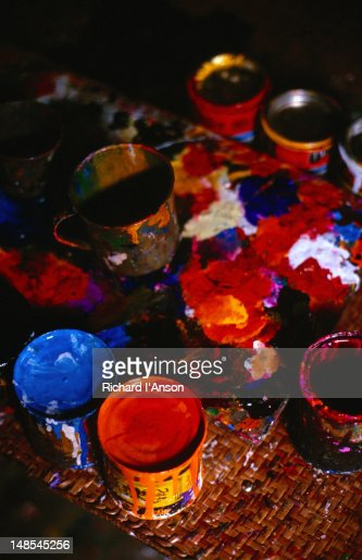 Tools of the trade, paint pots in a ' bicycle st ' workshop, although over 70,000 rickshaws roll out per year, the painted decoration of them has scarcely changed since the first one appeared on the streets of Dhaka in the early 1930's