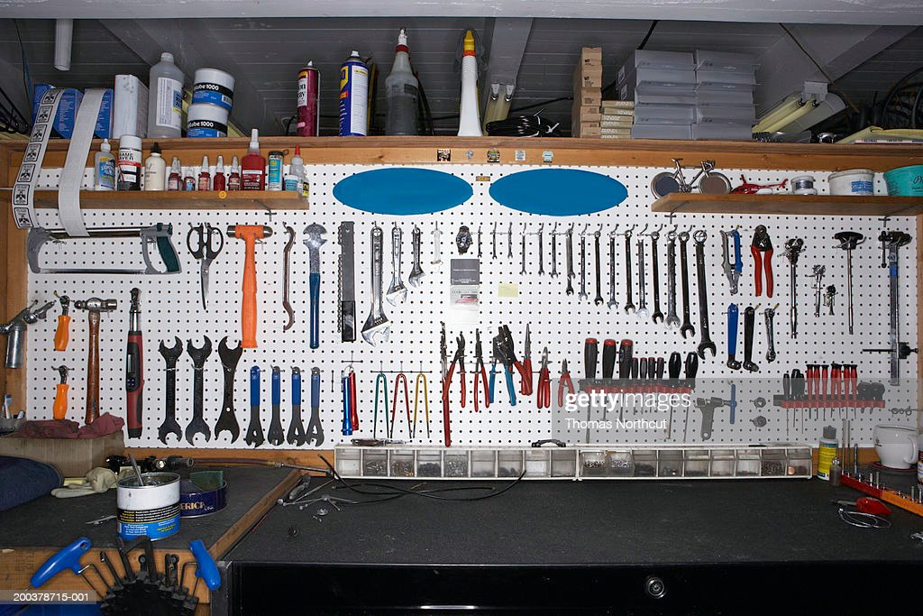 Tools on wall in bicycle shop : Stock Photo