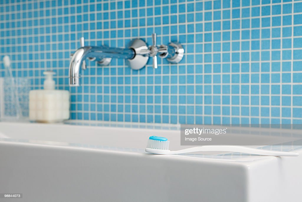 Toothbrush on side of sink