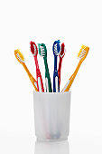 Toothbrushes in a toothbrush tumbler
