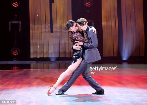 Top 10 contestant Lex Ishimoto and allstar Gaby Diaz perform an Argentine Tango routine to Red Black choreographed by Miriam Larici Leonardo...