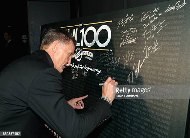 Top 100 player Borje Salming signs a poster board backstage during the NHL 100 presented by GEICO show as part of the 2017 NHL AllStar Weekend at the...