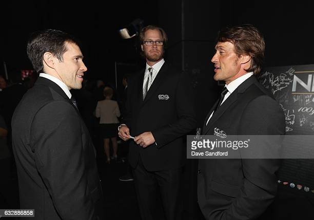 NHL Top 100 players Pavel Datsyuk Chris Pronger and Teemu Selanne stand backstage during the NHL 100 presented by GEICO show as part of the 2017 NHL...