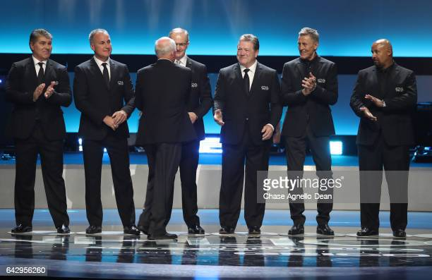 NHL Top 100 players Ray Bourque Paul Coffey Billy Smith Al MacInnis Denis Potvin Borje Salming and Grant Fuhr stand onstage during the NHL 100...