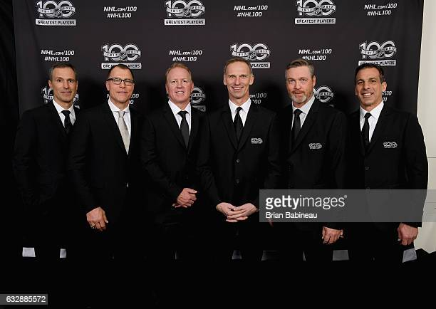 Top 100 players Scott Niedermayer Scott Stevens Brian Leetch Martin Brodeur Dominik Hasek Patrik Roy and Chris Chelios pose for a portrait at the...