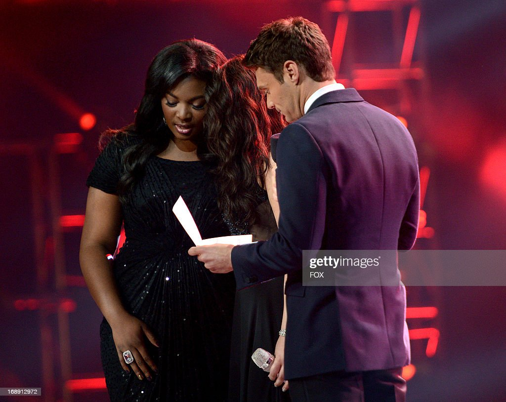Top 2 contestants Candice Glover, Kree Harrison and host Ryan Seacrest onstage at FOX's 'American Idol' Season 12 Live Finale Show at Nokia Theatre L.A. Live on May 16, 2013 in Los Angeles, California.