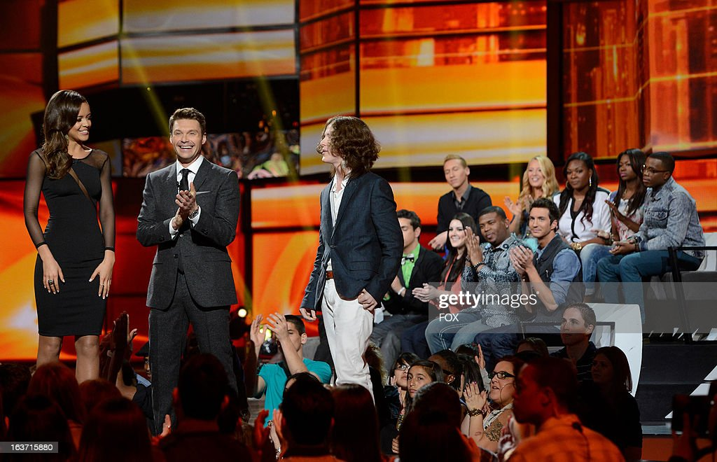 Top 24 contestant Aubrey Cleland, host Ryan Seacrest and top 24 contestant Charlie Askew onstage at FOX's 'American Idol' Season 12 Top 10 To 9 Live Elimination Show on March 14, 2013 in Hollywood, California.
