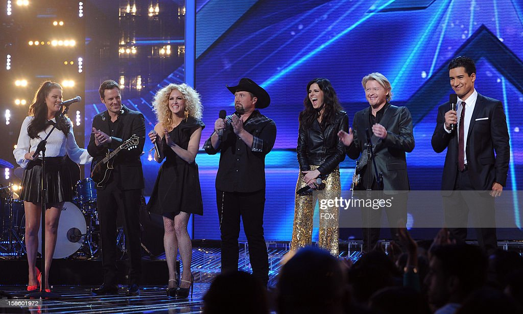 Top 3 contestant Tate Stevens (C), hosts Khloe Kardashian Odom (L) and Mario Lopez (R) and Jimi Westbrook, Kimberly Schlapman, Karen Fairchild and Phillip Sweet of 'Little Big Town' onstage at FOX's 'The X Factor' Season 2 Top 3 Live Performance Show on December 19, 2012 in Hollywood, California.