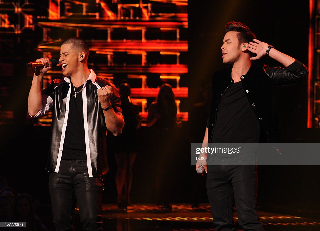 Top 3 finalist Carlito Olivero and Prince Royce perform onstage on FOX's 'The X Factor' Season 3 Top 3 Live Finale Performance Show on December 18, 2013 in Hollywood, California.