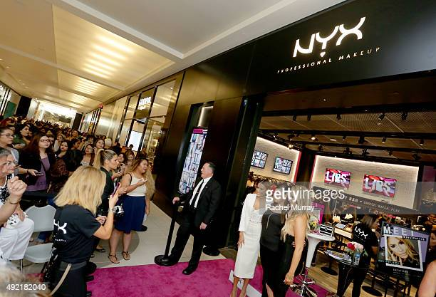 Top beauty influencers Desimakeup and Chrisspy pose with fans for photos during their meet and greet at the grand opening celebration of the NYX...