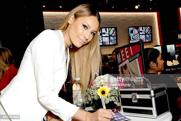 Top beauty influencers Desimakeup signs autographs for fans during her meet and greet at the grand opening celebration of the NYX Cosmetics store in...