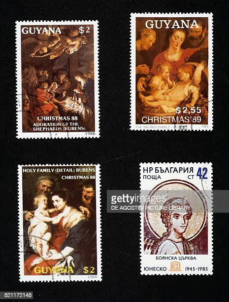 Top bottom and left postage stamps honouring Christmas with paintings by Rubens and a Motherhood 1988 and 1989 Guyana bottom right postage stamp...