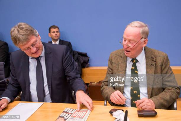 Top candidate of Alternative for Germany Alexander Gauland and chaiman Joerg Meuthen look at a Bild newspaper at the beginning of a press conference...