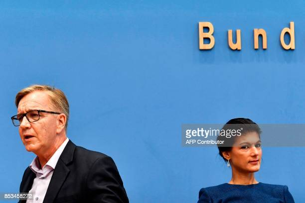 Top candidate of Die Linke party Sahra Wagenknecht and Dietmar Bartsch are seen prior a press conference in Berlin on September 25 one day after...