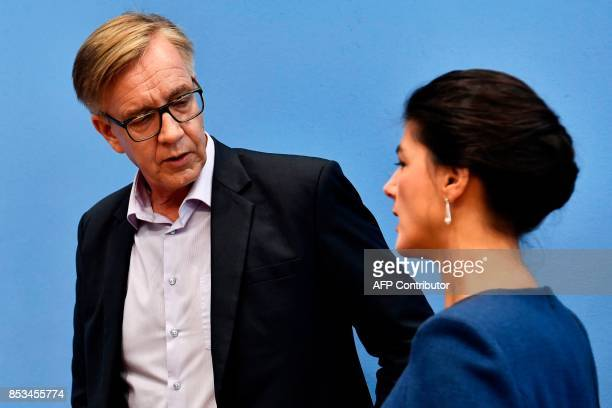 Top candidate of Die Linke party Sahra Wagenknecht and Dietmar Bartsch leave a press conference in Berlin on September 25 one day after general...