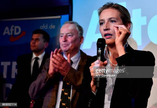 Top candidate of the Alternative for Germany Alice Weidel addresses supporters next to top candidate of the Alternative for Germany Alexander Gauland...