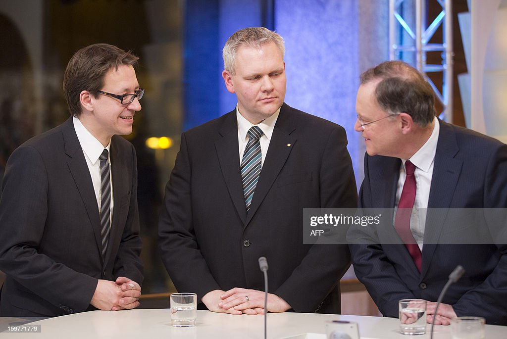 Top candidate of the Free Liberals, FDP, Stefan Birkner (L) and Bjoern Thuemler (C) of thr CDU and Stephan Weil of the SPD speak in a TV studio at the Landtag regional parliament in Hanover on January 20, 2013 on polling day of the local elections in the central German state of Lower Saxony. The vote is largely seen as a test run for Chancellor Angela Merkel, her rivals and would-be heirs, eight months before nationwide polls. German Chancellor Angela Merkel's party was ahead after the first state poll in a general election year, exit polls indicated, but it was unclear whether its coalition would cling to power.