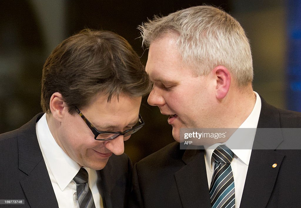Top candidate of the Free Liberals, FDP, Stefan Birkner (L) and Bjoern Thuemler of thr CDU speak in a TV studio at the Landtag regional parliament in Hanover on January 20, 2013 on polling day of the local elections in the central German state of Lower Saxony. The vote is largely seen as a test run for Chancellor Angela Merkel, her rivals and would-be heirs, eight months before nationwide polls. German Chancellor Angela Merkel's party was ahead after the first state poll in a general election year, exit polls indicated, but it was unclear whether its coalition would cling to power.