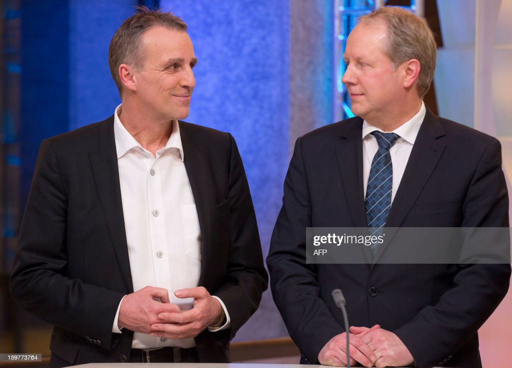 Top candidate of the Green Party, Stefan Wenzel (L) and Stefan Schostok of the SPD speak in a TV studio at the Landtag regional parliament in Hanover on January 20, 2013 on polling day of the local elections in the central German state of Lower Saxony. The vote is largely seen as a test run for Chancellor Angela Merkel, her rivals and would-be heirs, eight months before nationwide polls. German Chancellor Angela Merkel's party was ahead after the first state poll in a general election year, exit polls indicated, but it was unclear whether its coalition would cling to power. AFP PHOTO / POOL / JOERG SARBACH