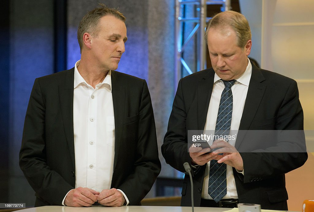 Top candidate of the Green Party, Stefan Wenzel (L) and Stefan Schostok of the SPD are seen in a TV studio at the Landtag regional parliament in Hanover on January 20, 2013 on polling day of the local elections in the central German state of Lower Saxony. The vote is largely seen as a test run for Chancellor Angela Merkel, her rivals and would-be heirs, eight months before nationwide polls. German Chancellor Angela Merkel's party was ahead after the first state poll in a general election year, exit polls indicated, but it was unclear whether its coalition would cling to power.